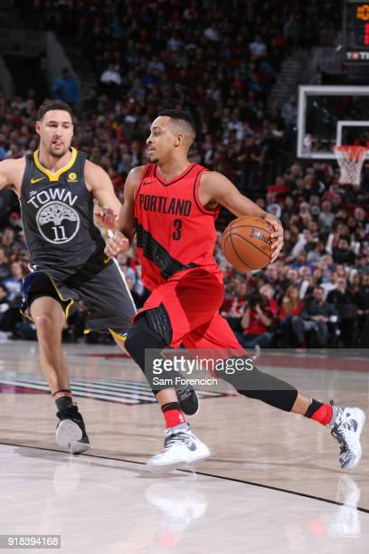 McCollum of the Portland Trail Blazers handles the ball during the game against the Golden State Warriors on February 14 2018 at the Moda Center in...
