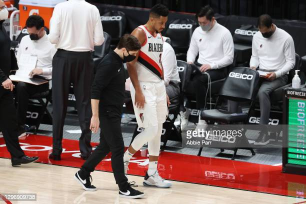 McCollum of the Portland Trail Blazers has a conversation with a team attendant in the second quarter against the Atlanta Hawks at Moda Center on...
