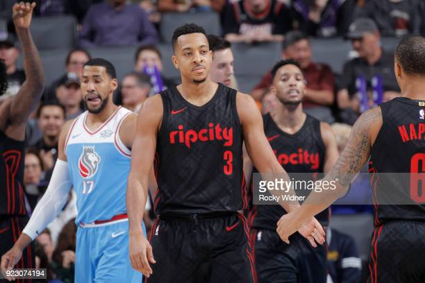 J McCollum of the Portland Trail Blazers high fives a teammate during the game against the Sacramento Kings on February 9 2018 at Golden 1 Center in...