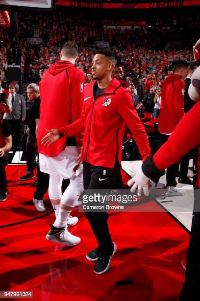 McCollum of the Portland Trail Blazers high fives his teammates before the game against the New Orleans Pelicans in Game Two of Round One of the 2018...