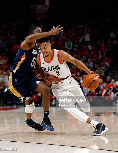 J McCollum of the Portland Trail Blazers is guarded by E'Twaun Moore of the New Orleans Pelicans during Game One of the Western Conference...