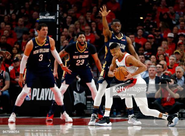J McCollum of the Portland Trail Blazers is guarded by Ian Clark of the New Orleans Pelicans during Game One of the Western Conference Quarterfinals...