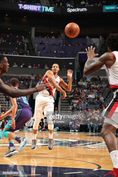 McCollum of the Portland Trail Blazers passes the ball against the Charlotte Hornets on December 16 2017 at Spectrum Center in Charlotte North...