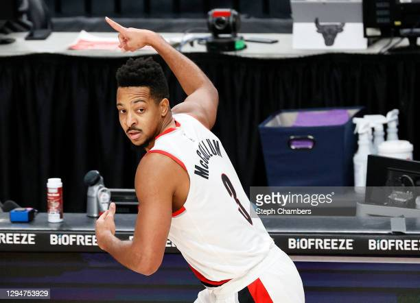 McCollum of the Portland Trail Blazers reacts after his three point basket against the Chicago Bulls in the first quarter at Moda Center on January...