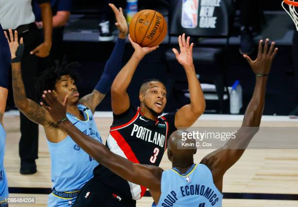 McCollum of the Portland Trail Blazers shoot against the Memphis Grizzlies and during the first quarter in the Western Conference play-in game one at...