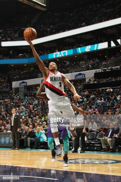 McCollum of the Portland Trail Blazers shoots a lay up against the Charlotte Hornets on December 16 2017 at Spectrum Center in Charlotte North...