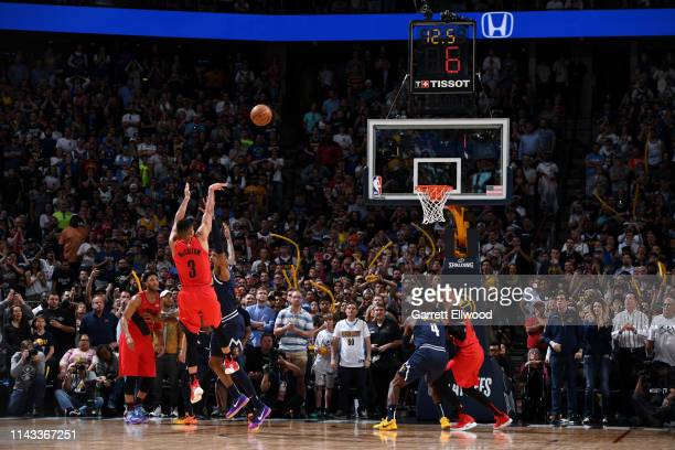 McCollum of the Portland Trail Blazers shoots a three-point basket over Torrey Craig of the Denver Nuggets during Game Seven of the Western...