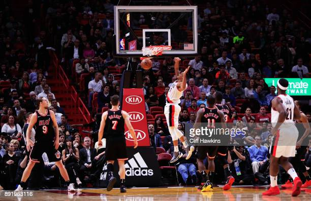 McCollum of the Portland Trail Blazers shoots against the Miami Heat in the se cond quarter at American Airlines Arena on December 13 2017 in Miami...
