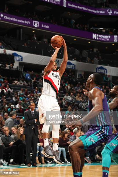 McCollum of the Portland Trail Blazers shoots the ball against the Charlotte Hornets on December 16 2017 at Spectrum Center in Charlotte North...