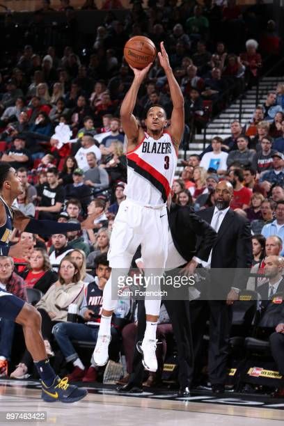 McCollum of the Portland Trail Blazers shoots the ball against the Denver Nuggets on December 22 2017 at the Moda Center in Portland Oregon NOTE TO...
