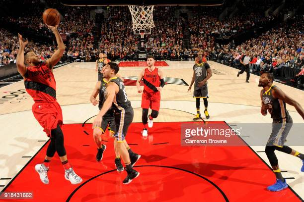 McCollum of the Portland Trail Blazers shoots the ball against the Golden State Warriors on February 14 2018 at the Moda Center in Portland Oregon...