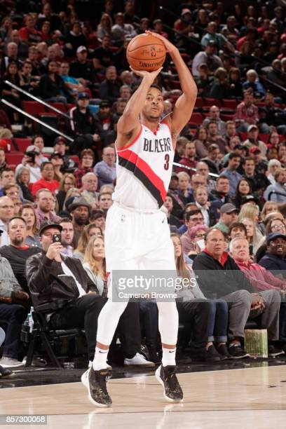 McCollum of the Portland Trail Blazers shoots the ball during a preseason game against the Phoenix Suns on October 3 2017 at the Moda Center in...