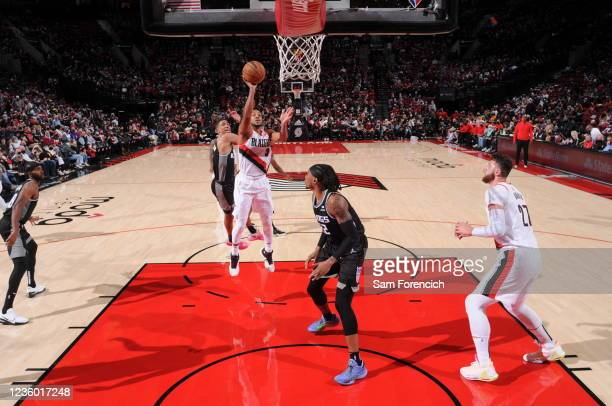 McCollum of the Portland Trail Blazers shoots the ball during the game against the Sacramento Kings on October 20, 2021 at the Moda Center Arena in...
