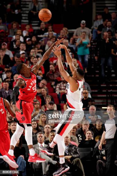 McCollum of the Portland Trail Blazers shoots the ball during the preseason game against the Toronto Raptors on October 5 2017 at the Moda Center in...
