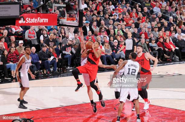 McCollum of the Portland Trail Blazers shoots the ball during the game against the San Antonio Spurs on January 7 2018 at the Moda Center in Portland...
