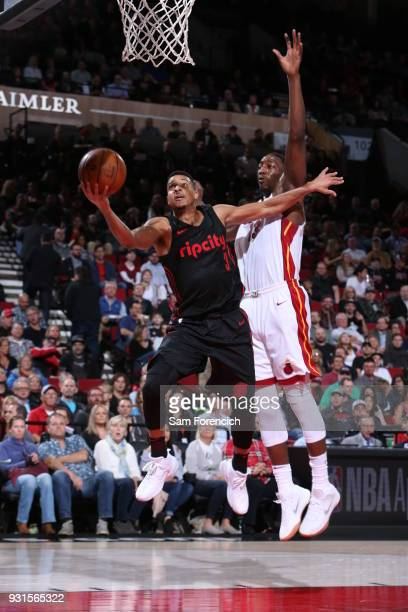 McCollum of the Portland Trail Blazers shoots the ball during the game against the Miami Heat on March 12 2018 at the Moda Center Arena in Portland...