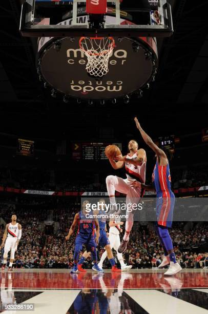 McCollum of the Portland Trail Blazers shoots the ball during the game against the Detroit Pistons on March 17 2018 at the Moda Center in Portland...