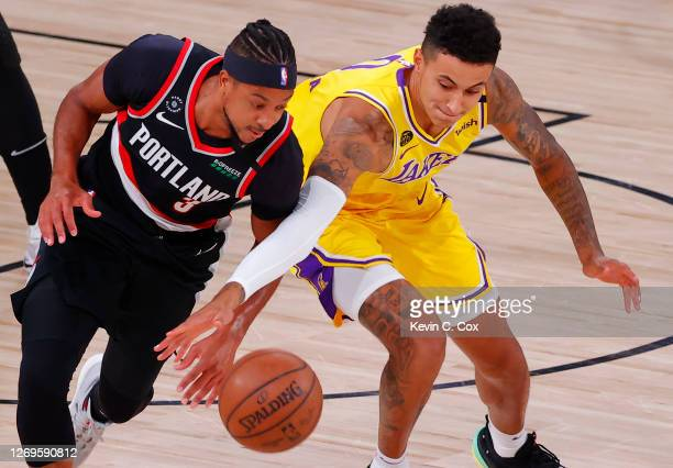 McCollum of the Portland Trail Blazers steals the ball from Kyle Kuzma of the Los Angeles Lakers during the first quarter in Game Five of the Western...