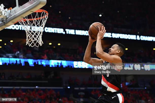 McCollum of the Portland Trail Blazers takes a shot against the New Orleans Pelicans during the first half of Game Four of the first round of the...