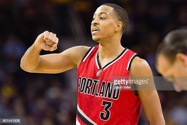J McCollum of the Portland Trail Blazers talks to his teammates during the first half against the Cleveland Cavaliers at Quicken Loans Arena on...