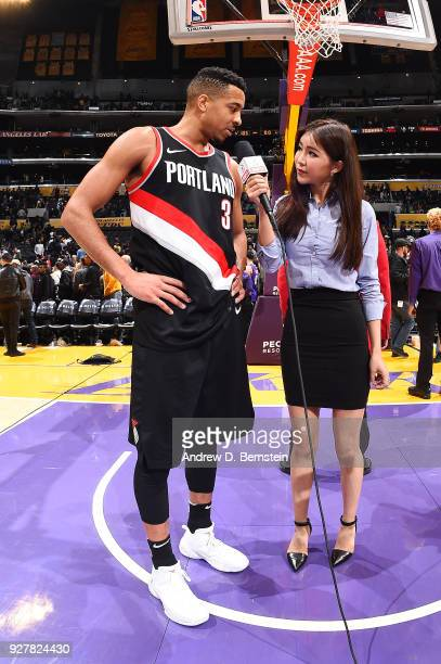 McCollum of the Portland Trail Blazers talks with Betty Zhou of China ESPN after the game against the Los Angeles Lakers on March 5 2018 at STAPLES...