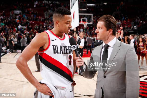 McCollum of the Portland Trail Blazers talks with the media after the game against the Detroit Pistons on March 17 2018 at the Moda Center in...