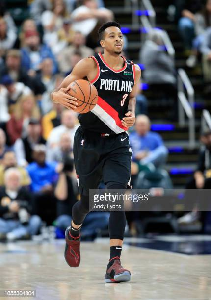 J McCollum of the Portland Trailblazers dribbles the ball against the Indiana Pacers at Bankers Life Fieldhouse on October 29 2018 in Indianapolis...