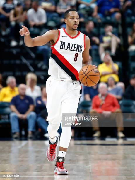 J McCollum of the Portland Trailblazers dribbles the ball against the Indiana Pacers at Bankers Life Fieldhouse on October 20 2017 in Indianapolis...