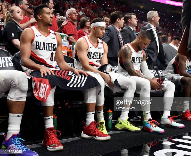 McCollum Seth Curry and Damian Lillard of the Portland Trail Blazers wait on the bench during a timeout during the second half of game four of the...