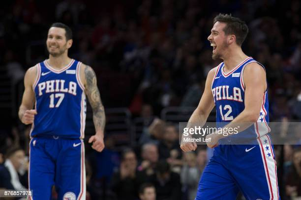 J McConnell and JJ Redick of the Philadelphia 76ers react in the second quarter against the Utah Jazz at the Wells Fargo Center on November 20 2017...