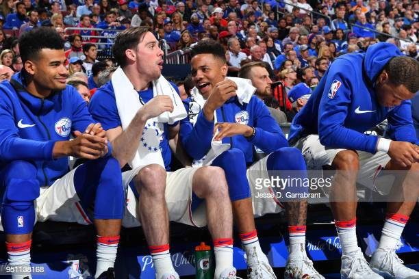 J McConnell and Markelle Fultz of the Philadelphia 76ers share a laugh from the bench during the game against the Miami Heat in Game Five of Round...
