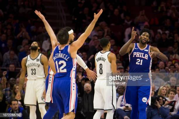J McConnell Ben Simmons and Joel Embiid of the Philadelphia 76ers react in front of Allen Crabbe and Spencer Dinwiddie of the Brooklyn Nets in the...