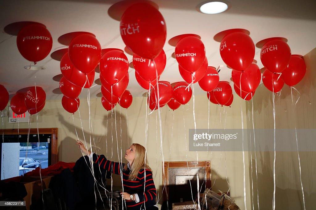 McConnell campaign volunteer Kara Townsend of London, Ky. arranges balloons before a campaign event for Senate Minority Leader Mitch McConnell (R-KY) at the Best Western Airport Expo on November 1, 2014 in Louisville, Kentucky. The most recent Bluegrass Poll shows McConnell with a five point lead over Democratic challenger Alison Lundergan Grimes.