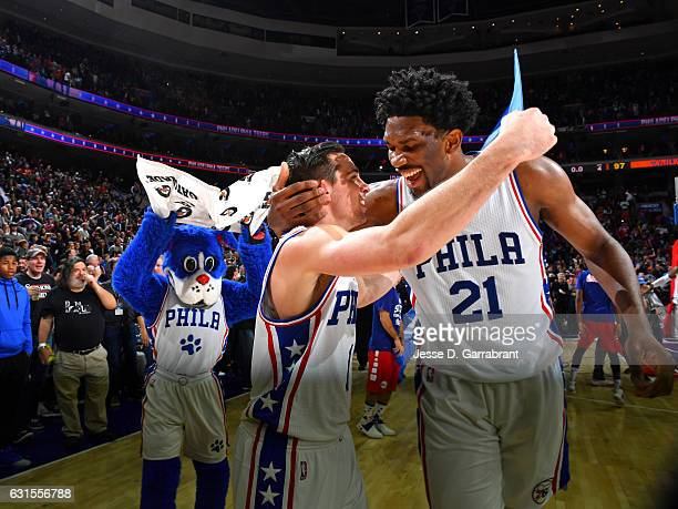 J McConnell celebrates with Joel Embiid of the Philadelphia 76ers after hitting the game winner against the New York Knicks on January 11 2017 in...