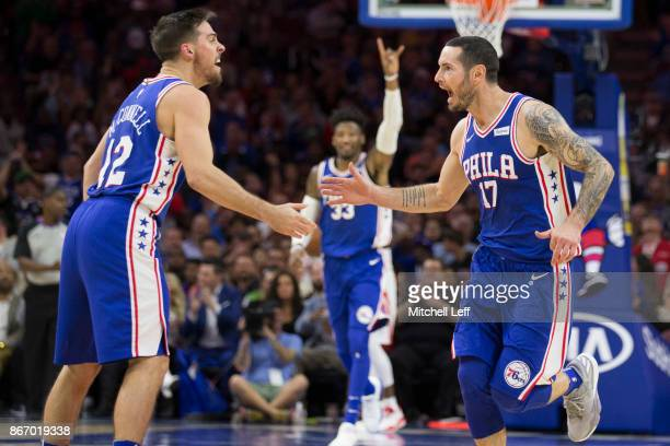 J McConnell JJ Redick and Robert Covington of the Philadelphia 76ers react against the Houston Rockets at the Wells Fargo Center on October 25 2017...