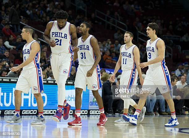 J McConnell Joel Embiid Hollis Thompson Nik Stauskas and Dario Saric of the Philadelphia 76ers walk off the court after a timeout in the game against...