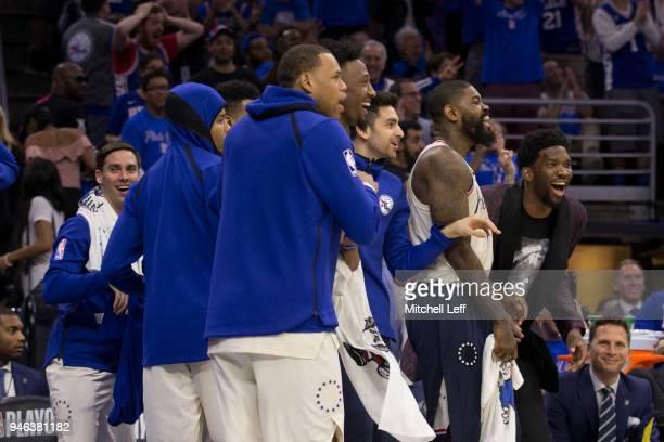 J McConnell Markelle Fultz Justin Anderson Robert Covington Furkan Korkmaz Amir Johnson and Joel Embiid of the Philadelphia 76ers react from the...