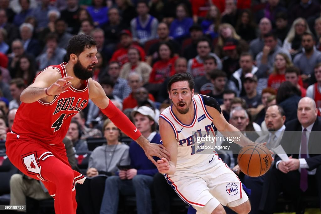 T. J. McConnell (12) of Philadelphia 76ers in action during an NBA basketball match between Chicago Bulls and Philadelphia 76ers at United Center in Chicago, Illinois, United States on December 18, 2017.