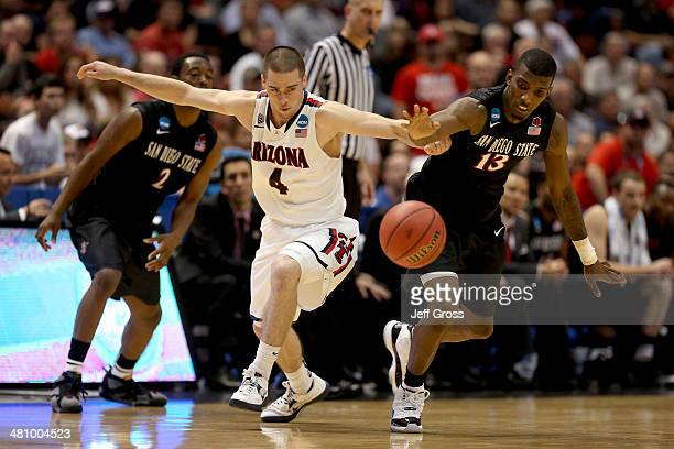 J McConnell of the Arizona Wildcats and Winston Shepard of the San Diego State Aztecs go for a loose ball in the second half during the regional...
