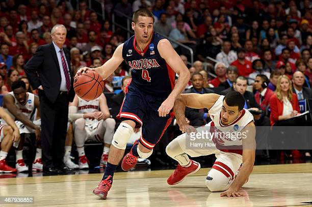 J McConnell of the Arizona Wildcats drives past Traevon Jackson of the Wisconsin Badgers in the first half during the West Regional Final of the 2015...
