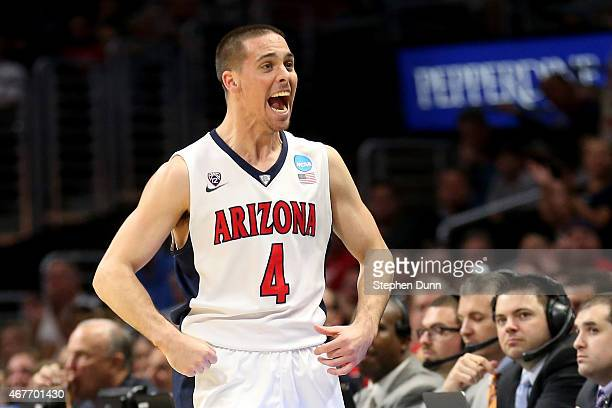 J McConnell of the Arizona Wildcats reacts after forcing a turnover by the Xavier Musketeers during the West Regional Semifinal of the 2015 NCAA...