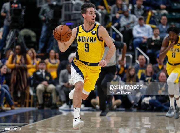 J McConnell of the Indiana Pacers brings the ball up court during the game against the Detroit Pistons at Bankers Life Fieldhouse on November 8 2019...