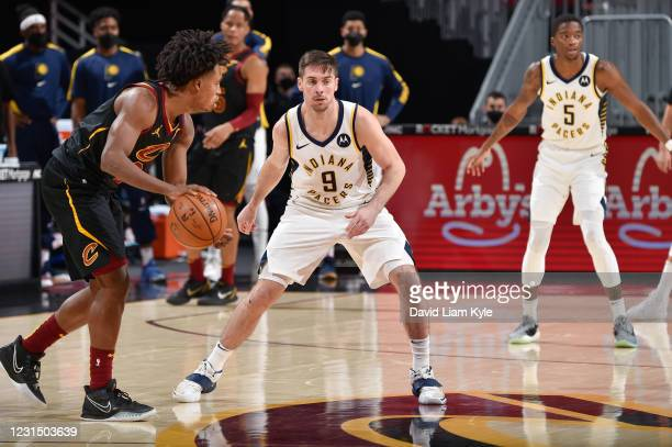 McConnell of the Indiana Pacers plays defense as Collin Sexton of the Cleveland Cavaliers dribbles during the game on March 3, 2021 at Rocket...