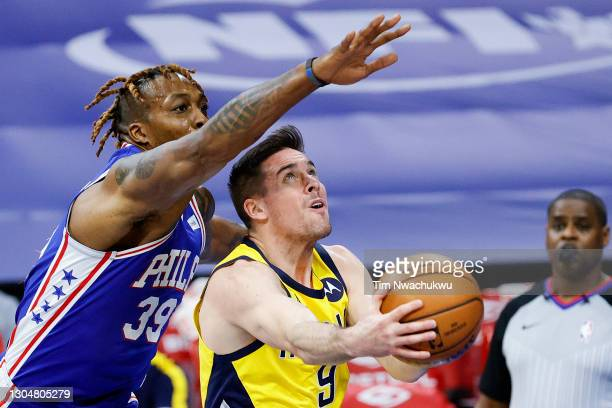 McConnell of the Indiana Pacers shoots under Dwight Howard of the Philadelphia 76ers during the second quarter at Wells Fargo Center on March 01,...