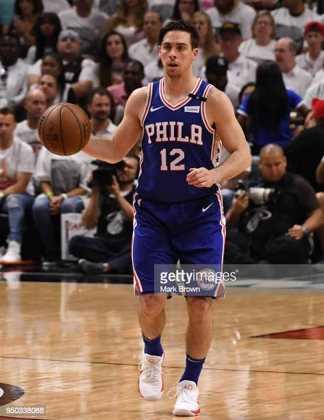 J McConnell of the Philadelphia 76ers brings the ball up the court in the third quarter against the Miami Heat during Game Four of Round One of the...