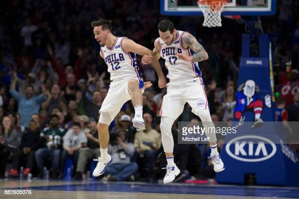 J McConnell of the Philadelphia 76ers celebrates with JJ Redick against the Orlando Magic at the Wells Fargo Center on November 25 2017 in...