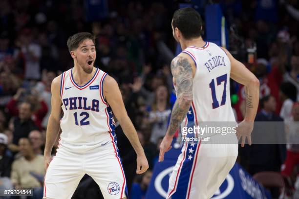 J McConnell of the Philadelphia 76ers celebrates with JJ Redick in the second quarter against the Orlando Magic at the Wells Fargo Center on November...