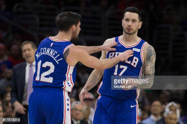 J McConnell of the Philadelphia 76ers celebrates with JJ Redick in the third quarter against the New York Knicks at the Wells Fargo Center on...