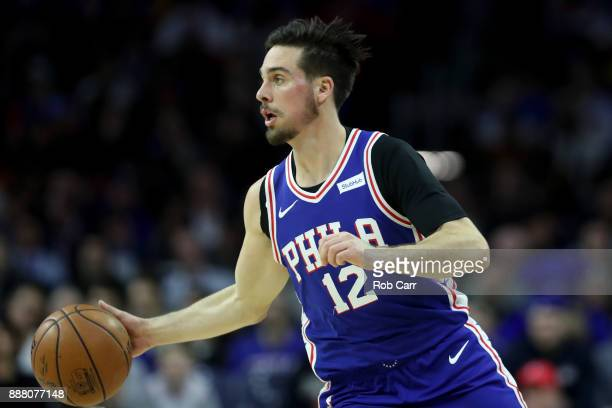 J McConnell of the Philadelphia 76ers dribbles the ball against the Los Angeles Lakers in the first half at Wells Fargo Center on December 7 2017 in...