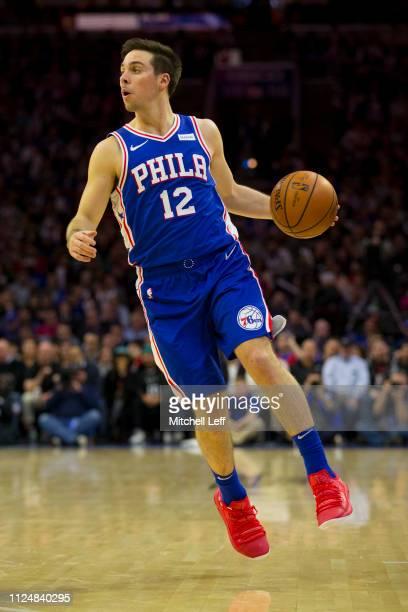 J McConnell of the Philadelphia 76ers dribbles the ball against the San Antonio Spurs at the Wells Fargo Center on January 23 2019 in Philadelphia...